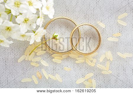 Gold wedding rings in studio up view