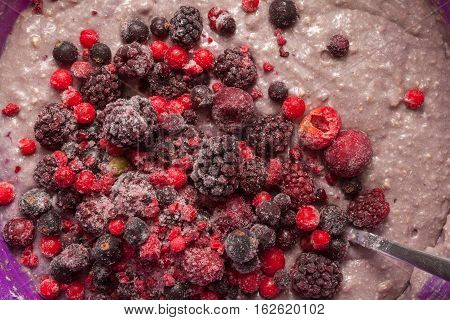 Cake mix with forest fruits up view