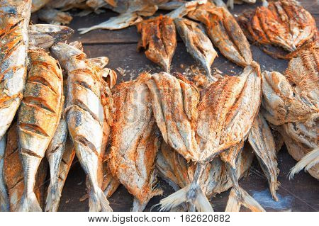 Exotic fish marketplace with bunches of fish in Asia