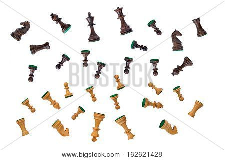 all black and white chess pieces set falling on white background
