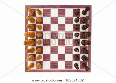 boxwood chessboard with all pieces on white background wide angle shot