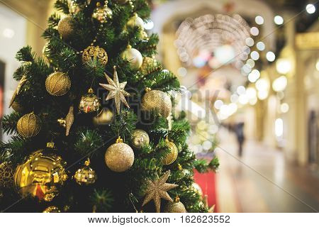 Toned photo of decorated fir with decorations in shopping mall
