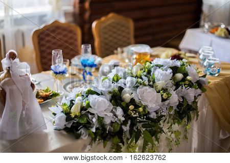 white flowers wedding accessories wedding preparation decorated wedding table with flowers wedding flowers food on the table decorated chairs table and chairs glasses fruit grapes salad on the table