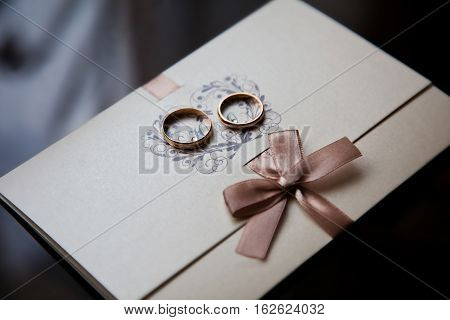 wedding rings on a white backgroundwedding bands invitation card