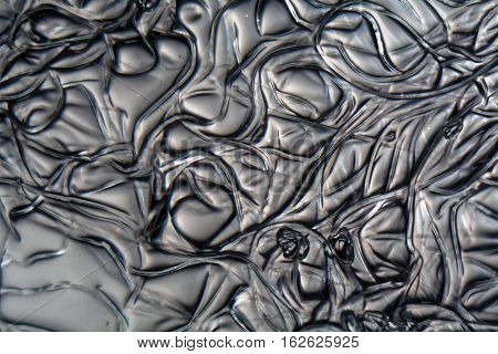 Fibers of Cellulose acetate under the microscope. Cellulose acetate is a synthetic material used for analog films cigarette filters glasses and many other things.