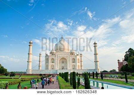 AGRA INDIA - SEPT 28: The people visit Taj Mahal Agra India on Sept 28 2013. The Taj Mahal is a mausoleum located in Agra India and is one of the most recognizable structures in the world