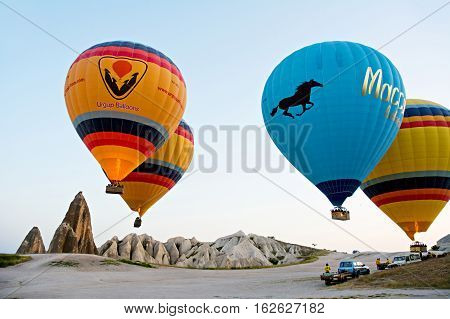 GOREME/ TURKEY - MAY 25 2015: Hot air balloons take off in Cappadocia on may 25 2015 in Goreme Cappadocia Turkey. The big attraction is the Cappadocia balloon flight.