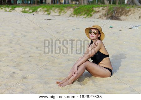 Lady relax on sand in Ban Krut Beach at Prachuap Khirikhun Province Thailand