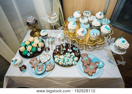 Table with loads of cakes, cupcakes, cookies and cakepops
