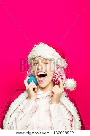 Cheerful Girl With Christmas Baubles