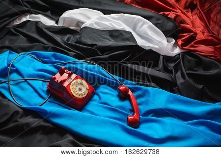 red dial phone on a crumpled tissue colored fabrics raw material red black blue white cloth linen cloth making clothes an interesting design decision the game colors background screensaver