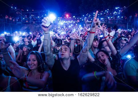 NOVI SAD - JULY 12 : CROWD IN FRONT OF THE DANCE ARENA AT EXIT 2015 MUSIC FESTIVAL JULY 12 2015 IN NOVI SAD PETROVARADIN FORTRESS SERBIA
