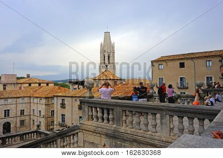 Girona, Spain - August 2, 2014: Visitors are exploring sights of the Medieval Quarter in the historic Girona center