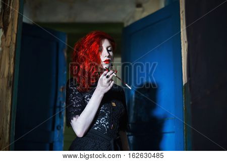 long-haired red-haired girl with a mouthpiece in hand