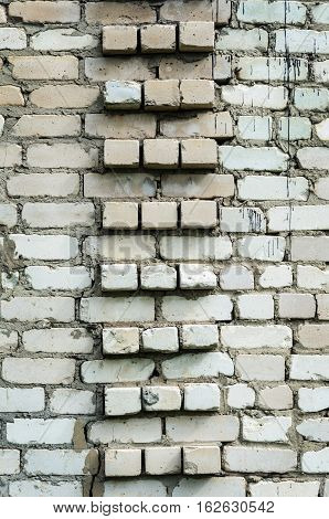 Background of old white brick wall surface with juncture