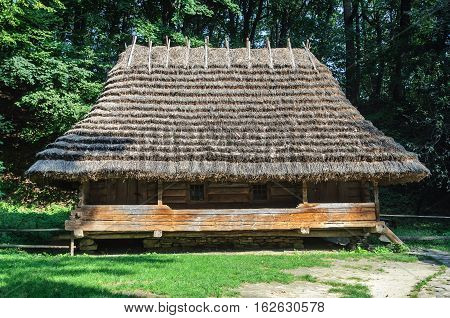 Lviv Ukraine - September 09 2016: Authentic Ukrainian wooden house with thatched roof from Oriavchik village Boyko's region Ukraine. Now in Museum of Folk Architecture in Lviv
