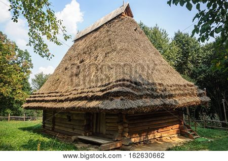 Lviv Ukraine - September 09 2016: Old Ukrainian authentic wooden house with thatched roof from Transcarpathian region Ukraine. Now in Museum of Folk Architecture in Lviv