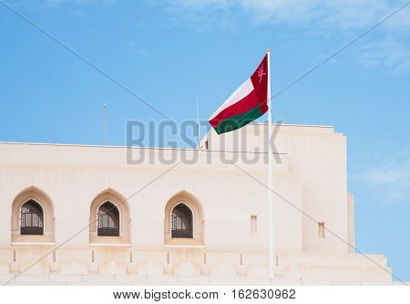 The flag of Oman at The Royal Opera House in Muscat one of many cultural projects initiated by Sultan Qaboos bin Said al Said.