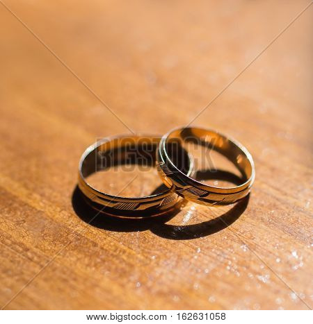infinity sign of the rings wedding rings on a yellow backgroundwedding bands