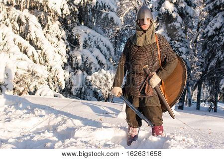 medieval warriorin in armor in the winter