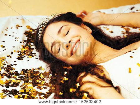 beauty young girl in gold confetti and tiara, little princess celebration hpliday, lifestyle people concept close up