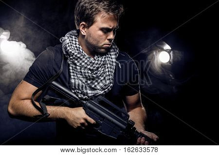 Soldier or mercenary wearing a shemagh with assault rifle paintball or airsoft gun. The image also depicts militarization of police or PMC private military companies poster