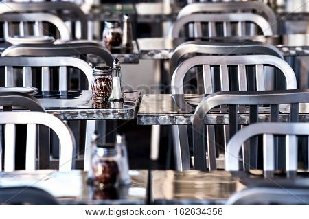 gleaming metal tables and chairs in a casual cafe