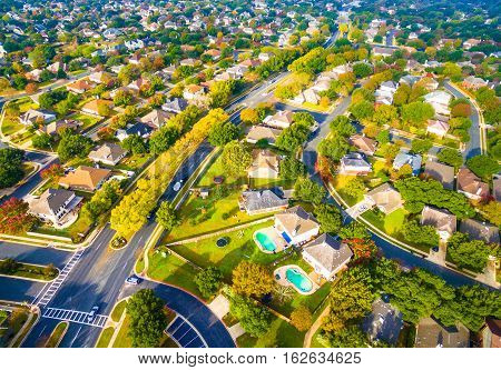 Birds Eye View Suburban Homes outside Austin , Texas near Round Rock , TX New Development with modern architecture and growing number of houses at golden hour with long shadows and gorgeous view