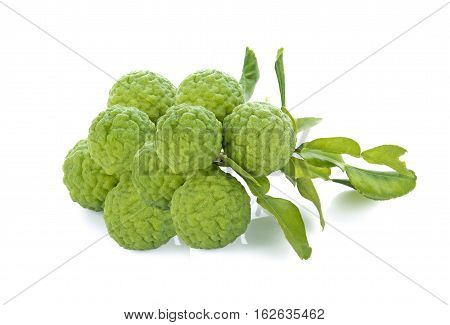 Bergamot and kaffir lime leaves on white background Work with path.