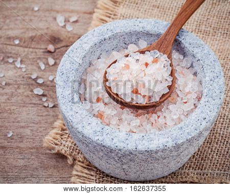 Himalayan Pink Salt In Mortar On Hemp Sack Background. Himalayan Salt Commonly Used In Cooking And F