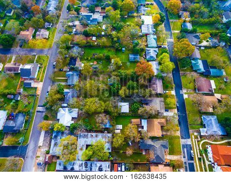 Looking down Birds Eye View historic Homes outside Austin , Texas Burnet road houses bird's eye view over colorful trees and rooftops of Homes from above