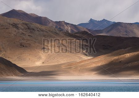 Beautiful Pangong Lake with mountain in background in Leh Ladakh, India.