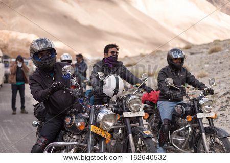 LADAKH, INDIA : 22 JULY 2016 - motorbike group stopped motorbike on the road waiting for maintenance land slide road at entry of Pangong lake in Ladakh, India on Jul 22,2016.