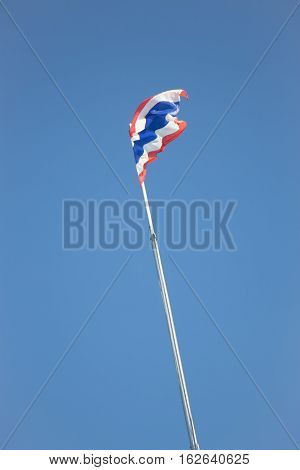 Thai flag of Thailand waving on blue sky stock photo