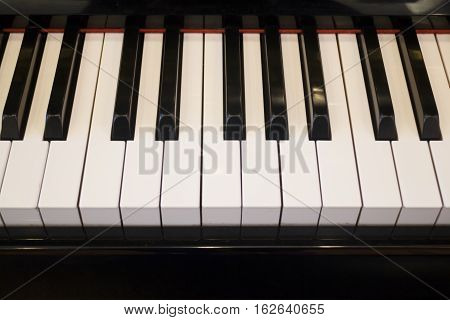 Piano keyboard colse up player view stock photo