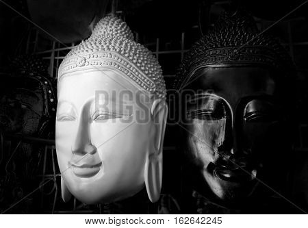 Black and white wooden mask of buddha at Thailand