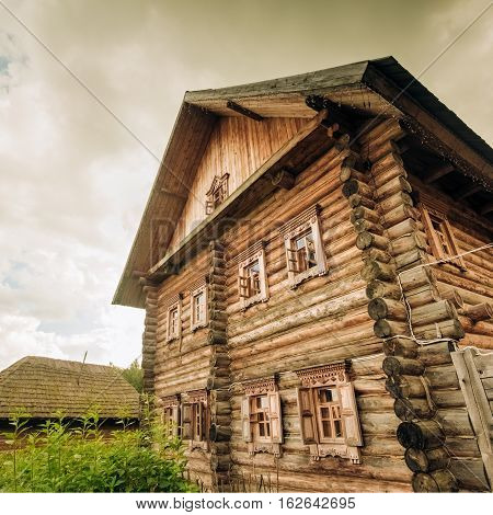 The Wooden two-story log house Slavic type