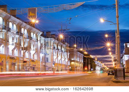 Gomel Belarus - August 19 2016: Night avenue of the city illuminated street and road traffic