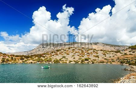 Three sailing boats in the Bay of panormitis Simi island , Dodecanese, Greece