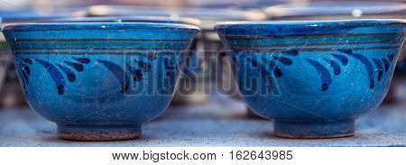 Two cups with traditional uzbekistan ornament on a street market of Bukhara Uzbekistan Central Asia. Silk Road