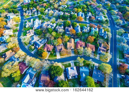 Colorful Fall Aerial Homes in Modern Suburb outside of Austin , Texas in Round Rock, TX. Curved streets , fall leaves and colorful trees around hill country