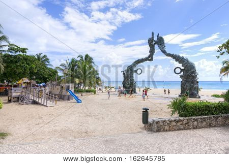 PLAYA DEL CARMEN MEXICO - NOVEMBER 8 2016: A playground for children in front of the Mayan monument on the beach makes Playa del Carmen a family-friendly Mexican Riviera travel destination.