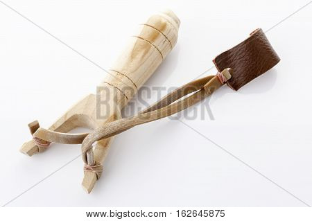 Catapult slingshot made from wood on white background