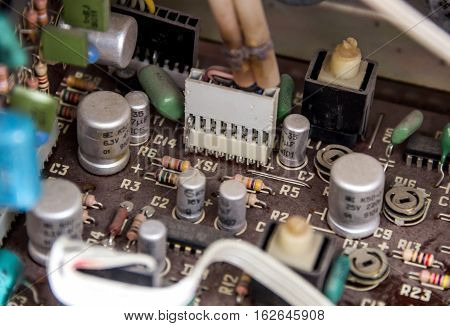 close-up electronic board of old tape recorder