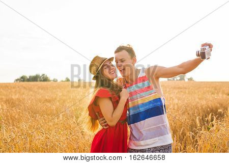 Young couple take photo by mobile phone.