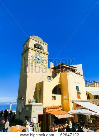 Capri, Italy - May 04, 2014: The people walking on Piazza Umberto I, the most famous square of the island of Capri, Italy on May 04, 2014