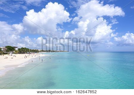 PLAYA DEL CARMEN MEXICO - NOVEMBER 8 2016: Beautiful turquoise water and white sandy beaches with coconut palms and small boutique hotels make Playa del Carmen an attractive vacation destination for tourists from all over the world.