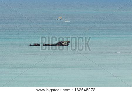 Wreck Yachts In A Blue Caribbean Sea