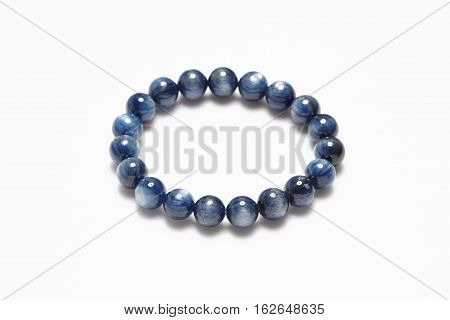 Lucky blue stone bracelet on white background.