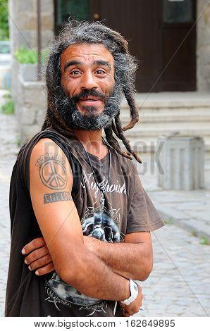 SOZOPOL BULGARIA - SEPTEMBER 7 2016: Portrait of a smiling happy man with dreadlocks